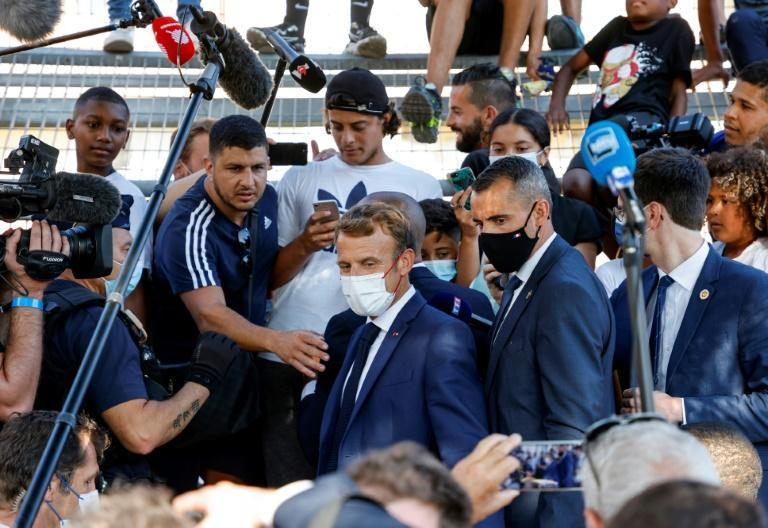 Macron met residents of the rundown district of Bassens on the first day of a three-day visit to Marseille (AFP/Ludovic MARIN)