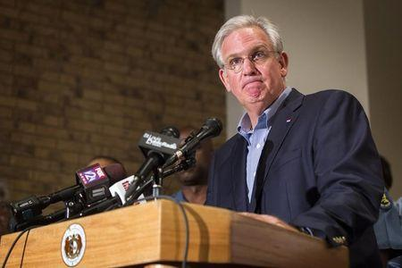 Missouri Governor Jay Nixon declares a state of emergency and curfew in response to looting the previous night in Ferguson, Missouri