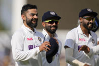 India's captain Virat Kohli smiles as he leaves the pitch for tea on day five of the fourth Test match at The Oval cricket ground in London, Monday, Sept. 6, 2021. (AP Photo/Kirsty Wigglesworth)