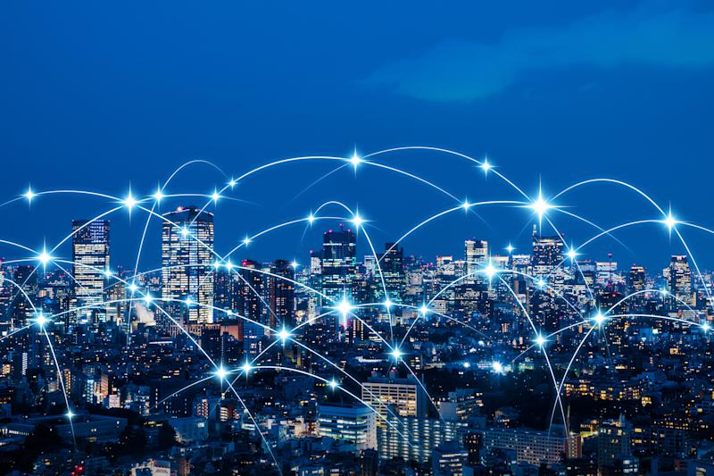 Image of a city skyline at night with connecting dots.