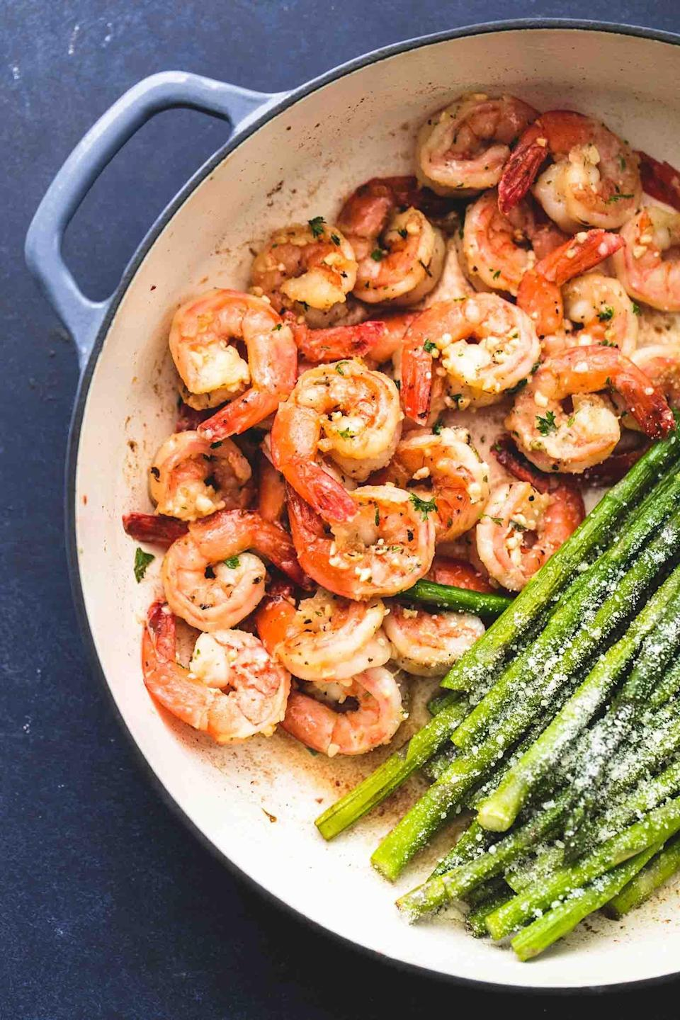 """<p>You can't go wrong when you top shrimp and asparagus with butter, herbs, and garlic. This <a href=""""http://www.lecremedelacrumb.com/one-pan-shrimp-and-asparagus/"""" class=""""link rapid-noclick-resp"""" rel=""""nofollow noopener"""" target=""""_blank"""" data-ylk=""""slk:one-pan meal"""">one-pan meal</a> even adds a sprinkle of Parmesan cheese.</p>"""