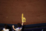 A San Diego Padres fan looks on as the Padres play the Los Angeles Dodgers in a baseball game Sunday, April 18, 2021, in San Diego. (AP Photo/Gregory Bull)