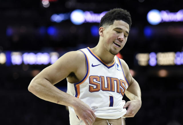 "<a class=""link rapid-noclick-resp"" href=""/nba/teams/pho"" data-ylk=""slk:Suns"">Suns</a> guard <a class=""link rapid-noclick-resp"" href=""/nba/players/5473/"" data-ylk=""slk:Devin Booker"">Devin Booker</a> is likely to miss several games after aggravating his right hamstring injury. (AP Photo/Michael Perez)"