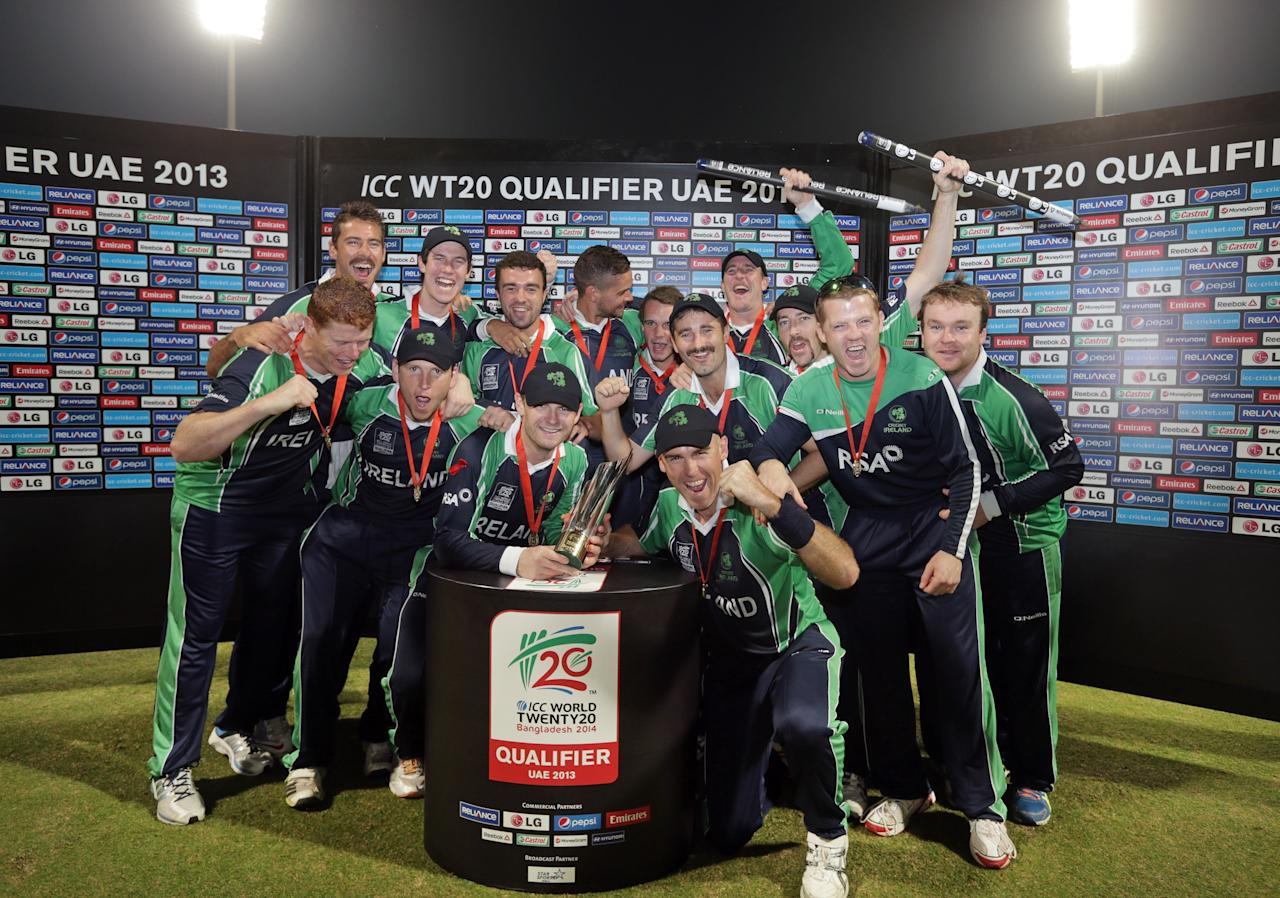 ABU DHABI - NOVEMBER 30: The Irish team celebrate on the stage after their victory over Afghanistan in the  Ireland v Afghanistan Final at the ICC World Twenty20 Qualifiers at the Zayed Cricket Stadium on November 30, 2013 in Abu Dhabi, United Arab Emirates.  (Photo by Graham Crouch-IDI/IDI via Getty Images)