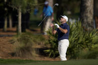Lee Westwood, of England, tosses his club after a bunker shot on the 15th hole during the final round of The Players Championship golf tournament Sunday, March 14, 2021, in Ponte Vedra Beach, Fla. (AP Photo/Gerald Herbert)