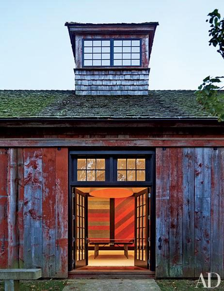 """Paris-based interior designer India Mahdavi oversaw the renovation of this <a rel=""""nofollow"""" href=""""http://www.architecturaldigest.com/story/india-mahdavi-litchfield-county-connecticut-home-article?mbid=synd_yahoo_rss"""">rustic compound</a>, comprising an old barn and several additions. Above is the restored games barn, one of the 150-acre property's outbuildings."""