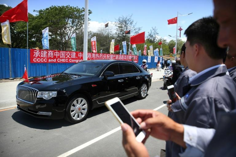 China's President Xi Jinping travels in a motorcade along the newly-dedicated Independence Drive Boulevard