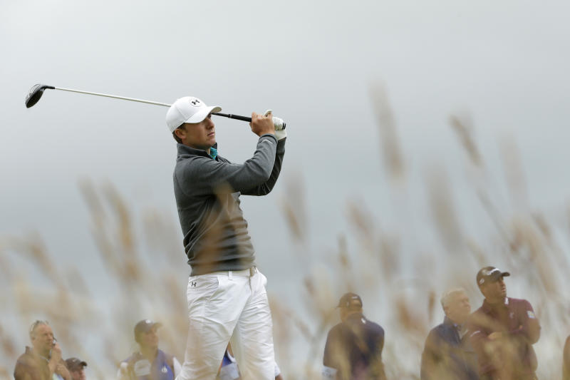 the latest  johnson in lead in uncompleted 2nd round of open