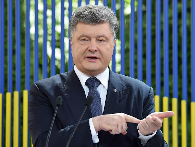 Ukrainian President Petro Poroshenko is trying to follow through on a February peace deal with separatist fighters, but its terms -- including partial self-rule for the insurgents -- are anathema to the nationalists (AFP Photo/Sergei Supinksky)