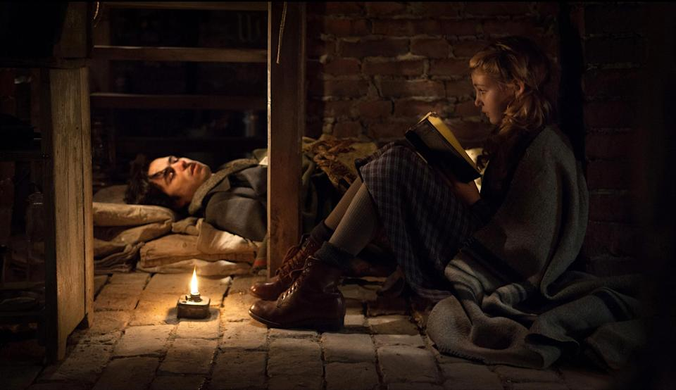 """This image released by 20th Century Fox shows Ben Schnetzer, left, and Sophie Nélisse in a scene from """"The Book Thief,"""" about a girl who loves books. (AP Photo/20th Century Fox, Jules Heath)"""