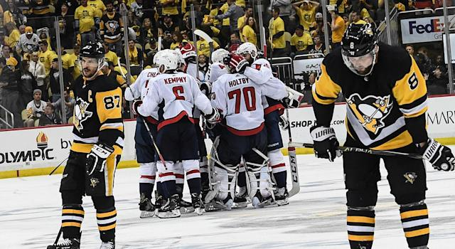 Don't adjust your screen: That is indeed the Capitals celebrating a series win over the Penguins. (Getty)