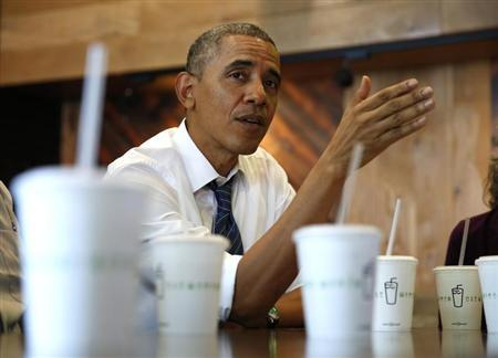 U.S. President Obama talks while having lunch with construction workers at Shake Shack in Washington
