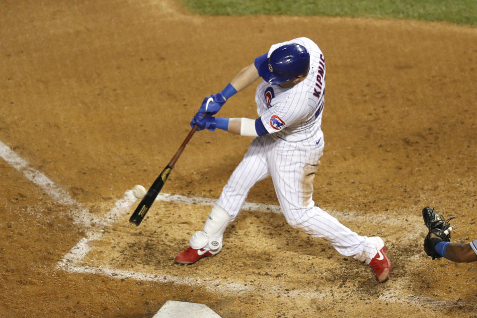Chicago Cubs' Jason Kipnis hits a two-run home run off Kansas City Royals starting pitcher Brady Singer during the fourth inning of a baseball game Tuesday, Aug. 4, 2020, in Chicago. (AP Photo/Charles Rex Arbogast)