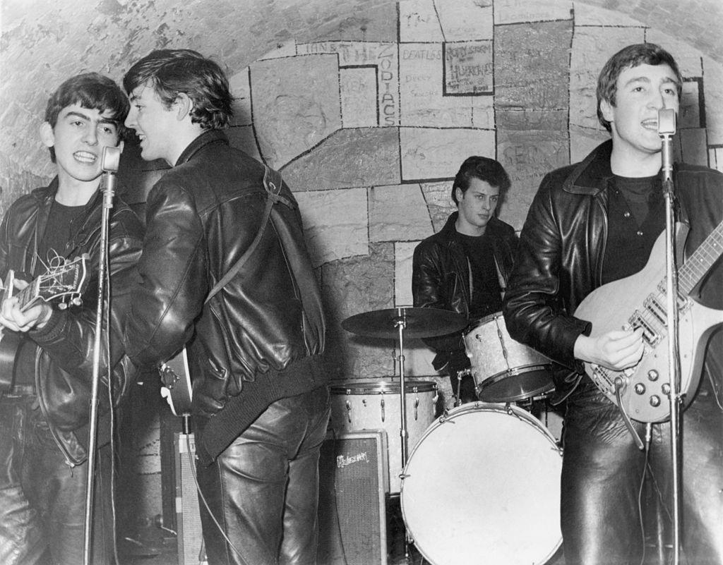 <p>The band defines its sound as rock 'n' roll and performs onstage at the Cavern Club for the first time in February 1961 in Liverpool, England. They would become the club's signature act and perform over 250 times.</p>