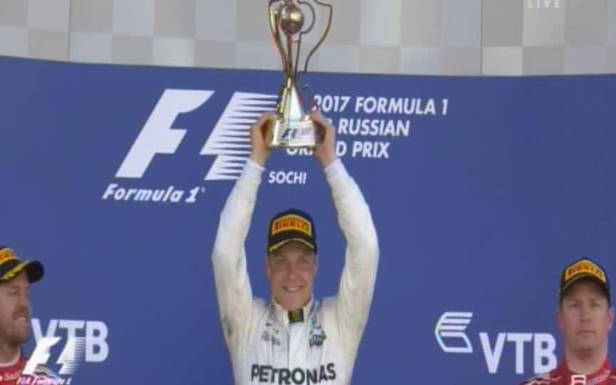 Valtteri Bottas lifts his first winner's trophy  - Credit: Sky Sports F1