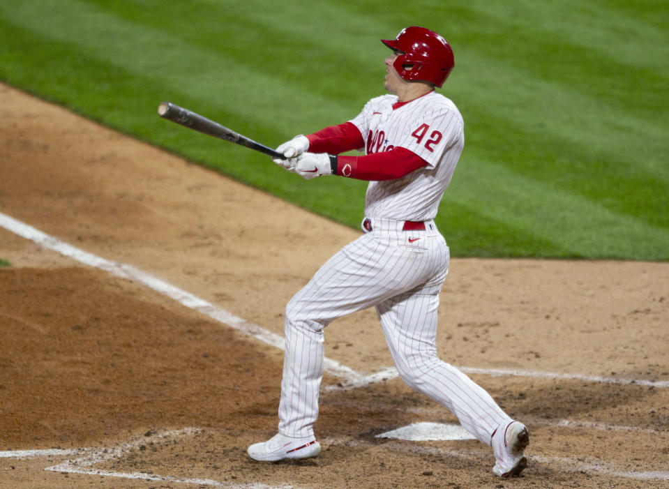 Philadelphia Phillies' JT Realmuto watches his two-run home run during the seventh inning of the team's baseball game against the St. Louis Cardinals, Friday, April 16, 2021, in Philadelphia. (AP Photo/Laurence Kesterson)