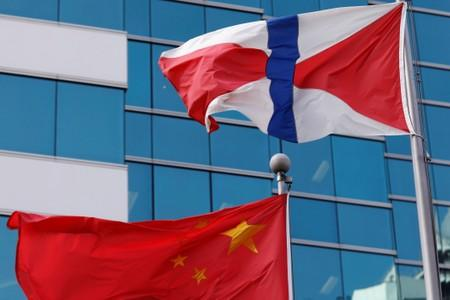 A Chinese national flag and Swire Group flag are seen in Hong Kong, China