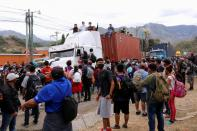 Hondurans take part in a new caravan of migrants, set to head to the United States, in Vado Hondo
