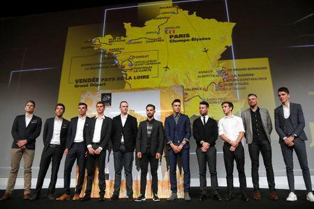 Tour de France riders pose in front of the map of the itinerary of the 2018 Tour de France cycling race during a news conference in Paris, France, October 17, 2017. REUTERS/Charles Platiau
