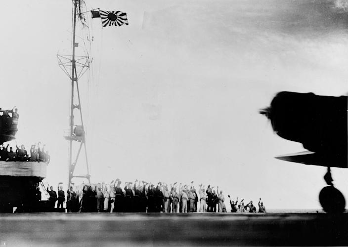 """<p>The crew of the Japanese carrier Shokaku cry """"banzai"""" as a Type 97 Kate carrier attack plane takes off as the second wave attack is launched on Pearl Harbor on Dec. 7, 1941. (U.S. Navy/National Archives/Handout via Reuters) </p>"""