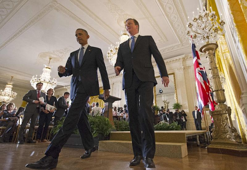 US President Barack Obama(L) and Britain's Prime Minister David Cameron make their way off the stage at the end of a press conference in the East Room of the White House on January 16, 2015 in Washington, DC (AFP Photo/Mandel Ngan)