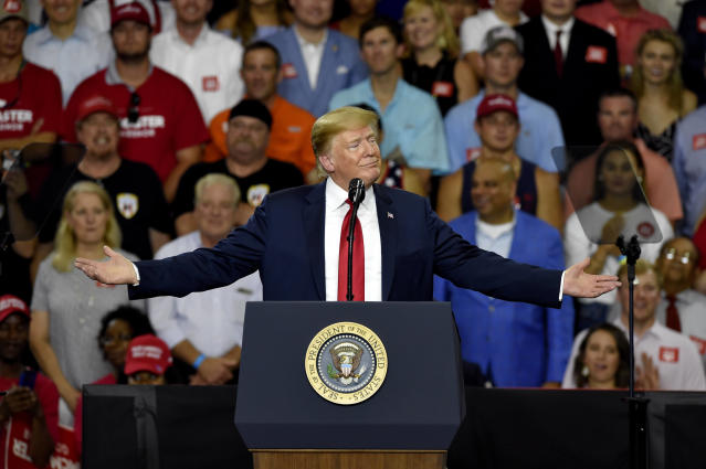 President Donald Trump, in town to support Gov. Henry McMaster, speaks to the crowd at Airport High School, Monday, June 25, 2018, in West Columbia, S.C. (AP Photo/Richard Shiro)