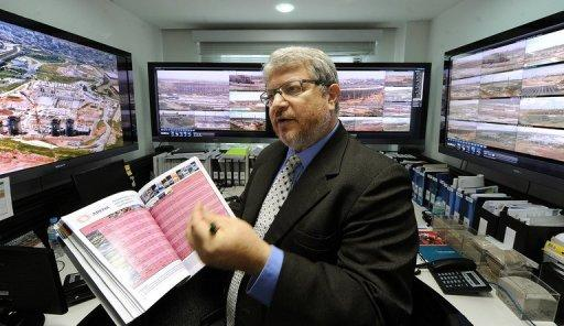 Ricardo Trade shows the control room from where the stadiums will be monitored during an interview with AFP