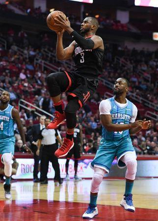 Dec 13, 2017; Houston, TX, USA; Houston Rockets guard Chris Paul (3) goes up for a shot ahead of Charlotte Hornets guard Kemba Walker (15) during the second quarter at Toyota Center. Shanna Lockwood-USA TODAY Sports