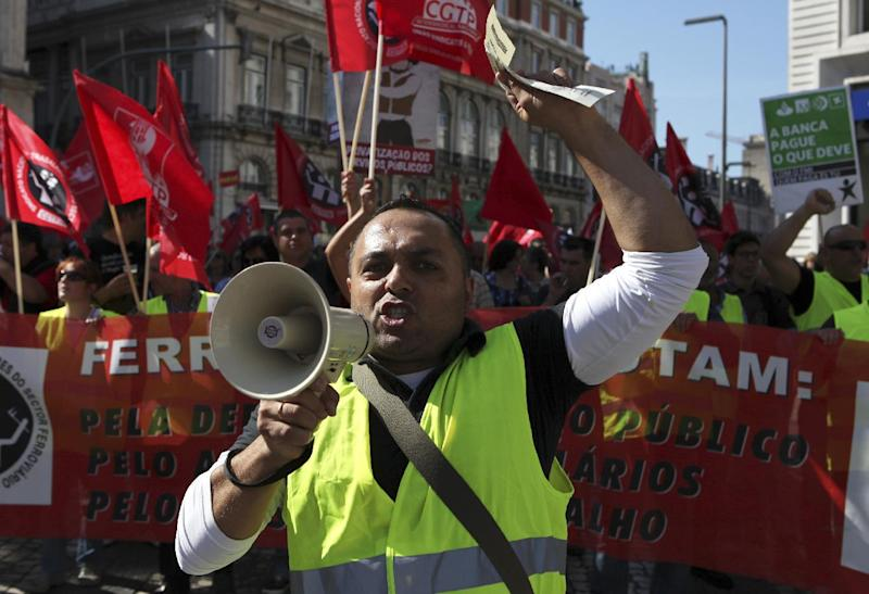 Railway workers march shouting slogans through downtown Lisbon during a workers unions' demonstration, Saturday, Sept. 29 2012. Thousands of Portuguese enduring deep economic pain from austerity cuts took to the streets Saturday in protest. (AP Photo/Joao Henriques)