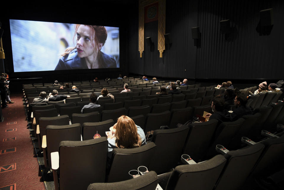 Moviegoers sitting in a socially distant seating arrangement at the AMC Lincoln Square 13 theater on the first day of reopened theaters after being closed due to the COVID-19 pandemic, Friday, March 5, 2021, in New York. (Photo by Evan Agostini/Invision/AP)