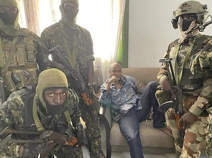 A handout photo made available by Guinea's military shows Alpha Condé, President of the Republic of Guinea (C) detained by army special forces in Conakry, Guinea, on 5 September.