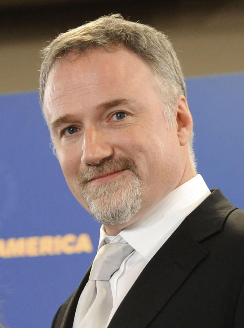 "FILE - In this Jan. 31, 2009 file photo, director David Fincher is shown backstage at the Directors Guild of America Awards  in Los Angeles. Fincher directed the 2011 thriller ""The Girl with the Dragon Tattoo.""  (AP Photo/Chris Pizzello, file)"