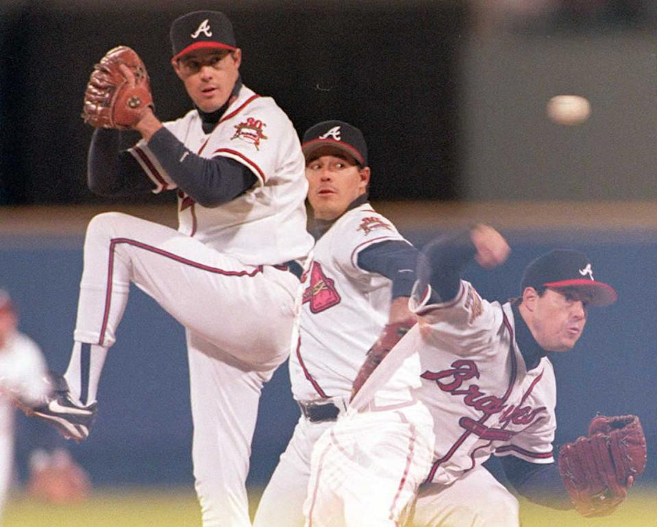 ATLANTA, UNITED STATES:  A multiple exposure shows Atlanta Braves Greg Maddux during game one of the first World Series game against the Cleveland Indians at Fulton County Stadium in Atlanta, Georgia 21 October. Maddux pitched a complete game defeating the Cleveland Indians 3-2. AFP PHOTO (Photo credit should read JEFF HAYNES/AFP/Getty Images)