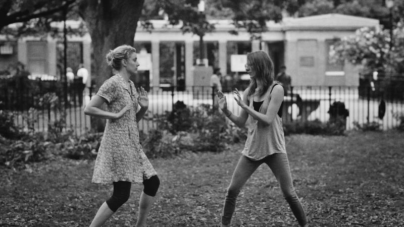 "This undated publicity photo released by the Independent Film Channel shows Greta Gerwig, left, as Frances and Mickey Sumner as Sophie play-fighting in a scene from the film, ""Frances Ha."" (AP Photo/IFC)"