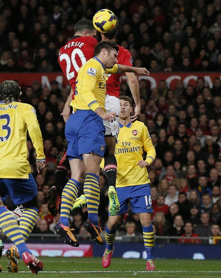 Manchester United's van Persie scores against Arsenal during their English Premier League soccer match in Manchester