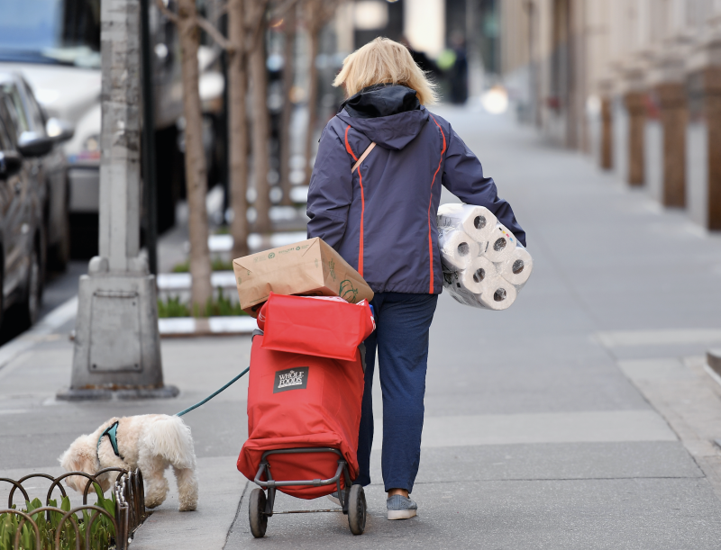A woman carries groceries and toilet paper on March 18, 2020 New York City. (Photo: ANGELA WEISS/AFP via Getty Images)