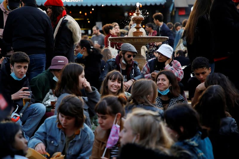 FILE PHOTO: French cafes and restaurants reopen their terraces to customers in Paris