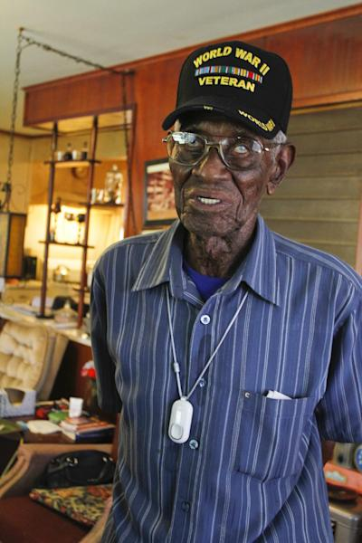 107-year-old Richard Overton, the oldest recorded living US veteran, walks around his home after being presented with the Philips Lifeline with AutoAlert service on Wednesday, June 5, 2013 in Austin, Texas. The medical alert service, which will help protect Overton as he continues to remain independent in his home, was provided free of charge for the rest his life in appreciation for his courageous service to our country. Overton served for the Army in the Pacific during World War II.(Jack Plunkett / AP Images for Philips Lifeline)