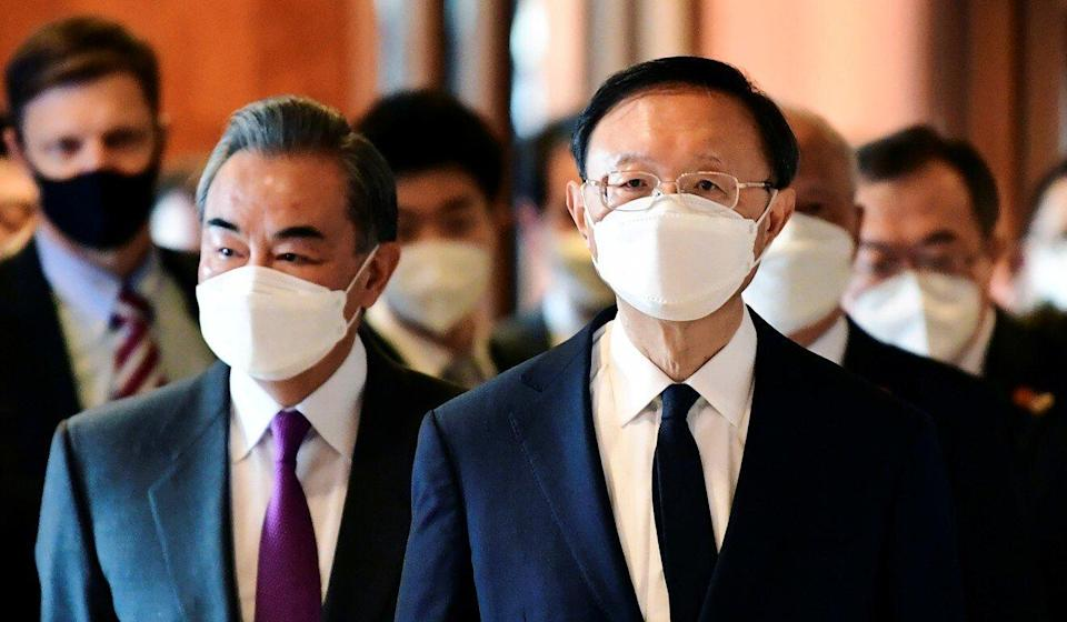 Chinese Foreign Minister Wang Yi (left) and top diplomat Yang Jiechi arrive for the meeting at a hotel in Anchorage. Photo: Reuters