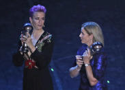 United States women's World Cup winning coach Jill Ellis and United States forward Megan Rapinoe pose after they received the Best FIFA coach award , best FIFA men's , Women's player award during the Best FIFA soccer awards ceremony, in Milan's La Scala theater, northern Italy, Monday, Sept. 23, 2019. (AP Photo/Antonio Calanni)