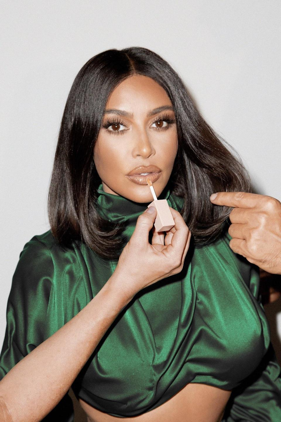"""<p>You didn't think we'd forget the first family of celebrity beauty brands, did you? The closest thing to an actual walking, talking human brand that we can think of, Kim Kardashian launched the KKW Beauty makeup line in 2017, followed shortly thereafter by KKW Fragrance. (Though, let us not forget, Kardashian launched a truly underrated eponymous fragrance in 2009.) In that time, even haters had to admit that the cosmetics and perfumes cranked out by KKW were really freakin' good, especially if you love <a href=""""https://www.allure.com/story/kim-kardashian-west-announces-kkw-beauty-lip-products-launch?mbid=synd_yahoo_rss"""" rel=""""nofollow noopener"""" target=""""_blank"""" data-ylk=""""slk:dramatic yet neutral"""" class=""""link rapid-noclick-resp"""">dramatic yet neutral</a> makeup looks and <a href=""""https://www.allure.com/story/kim-kardashian-kris-jenner-fragrance-kkw-beauty?mbid=synd_yahoo_rss"""" rel=""""nofollow noopener"""" target=""""_blank"""" data-ylk=""""slk:sultry floral fragrances"""" class=""""link rapid-noclick-resp"""">sultry floral fragrances</a>.</p> <p><strong>Star product:</strong> Because of the frequent introduction of new collections, some fan-favorite products can fly out the door and never come back. But we're hopeful that the <a href=""""https://shop-links.co/1747583470988062361"""" rel=""""nofollow noopener"""" target=""""_blank"""" data-ylk=""""slk:Nude Glosses"""" class=""""link rapid-noclick-resp"""">Nude Glosses</a> ($20 each) have found a permanent spot in KKW Beauty's lineup. """"Depending on the look you're going for, you can layer, mix and match the shades to go from <a href=""""https://www.allure.com/story/kkw-beauty-classic-2-eyeshadow-palette-nude-lip-gloss-kim-kardashian?mbid=synd_yahoo_rss"""" rel=""""nofollow noopener"""" target=""""_blank"""" data-ylk=""""slk:creamy to glossy"""" class=""""link rapid-noclick-resp"""">creamy to glossy</a> in a minute,"""" has said about the product. """"You can also wear them alone for a wash of shiny nude color.""""</p>"""