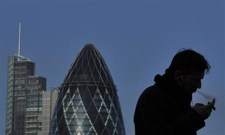 A worker smokes a cigar in the City of London