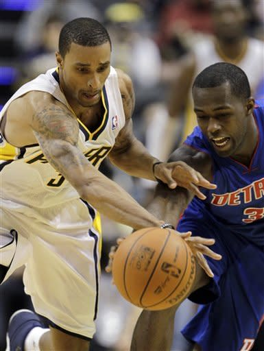 Indiana Pacers' George Hill, left, and Detroit Pistons' Rodney Stuckey go for a loose ball during the second half of an NBA basketball game Monday, Dec. 26, 2011, in Indianapolis. Indiana won 91-79. (AP Photo/Darron Cummings)
