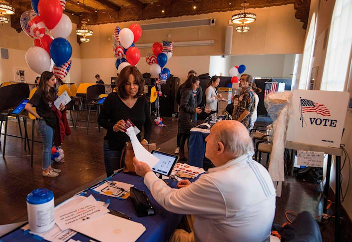 Residents cast their ballots during the Democratic presidential primary in Beverly Hills, California, on March 3, 2020.