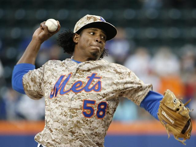 New York Mets starting pitcher Jenrry Mejia delivers in the first inning against the St. Louis Cardinals in a baseball game in New York, Monday, April 21, 2014. (AP Photo/Kathy Willens)