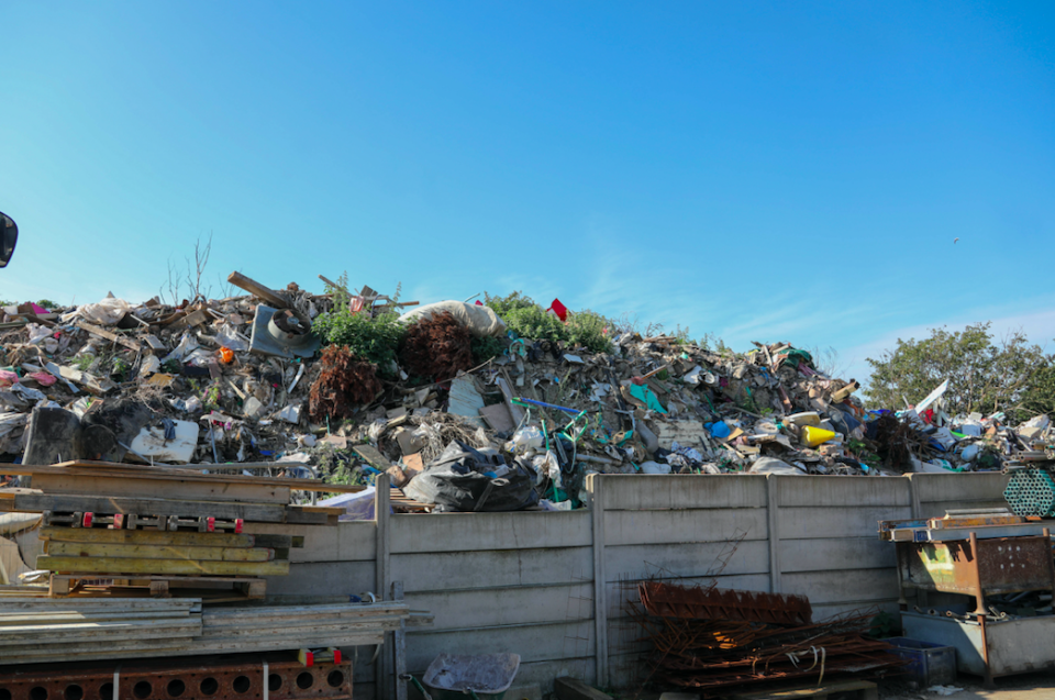 Stacks of household rubbish including bin liners, mattresses, wooden pallets and scrap metal are visible. (SWNS)