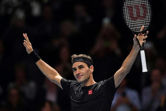 Roger Federer celebrates victory over Novak Djokovic at the ATP Finals (AFP Photo/Ben STANSALL)