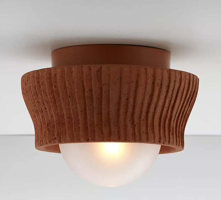 """I'm a big fan of terra-cotta and was pleasantly surprised to find it used for this flush-mount light. Wth delicate pleats made to resemble a fabric shade, fixture is a definite win. Plus, you can buy a large or small version—each with their own distinct details. $149, Crate & Barrel. <a href=""""https://www.crateandbarrel.com/roja-terracotta-small-flushmount-light/s123690"""" rel=""""nofollow noopener"""" target=""""_blank"""" data-ylk=""""slk:Get it now!"""" class=""""link rapid-noclick-resp"""">Get it now!</a>"""