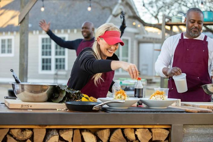 """Megan Day of Lee's Summit adds the finishing touches to her Team Brawl dish, as seen on """"BBQ Brawl,"""" Season 2."""
