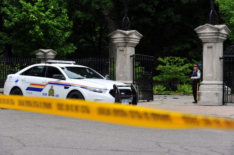 Canadian police stand guard outside Ottawa's Rideau Hall -- home to Prime Minister Justin Trudeau and Governor General Julie Payette -- after an armed man entered the grounds